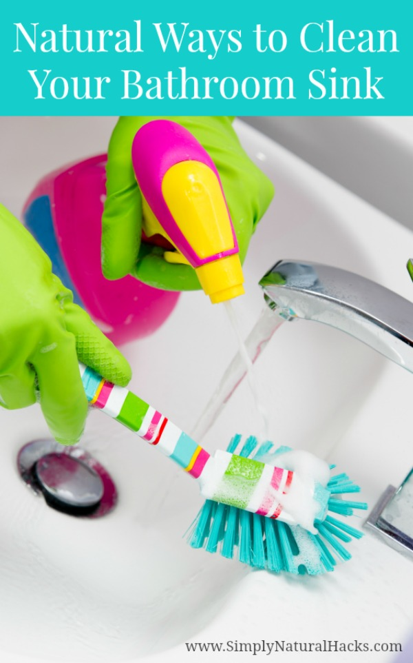 bright cleaner and brush in bathroom sink