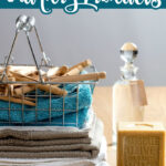 folded towels with homemade laundry soap and other natural cleaning products
